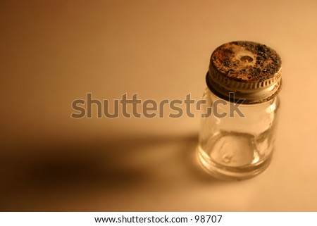 small glass bottle with hole in lid - stock photo