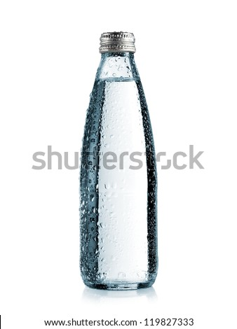 Small glass water bottle with drops - stock photo