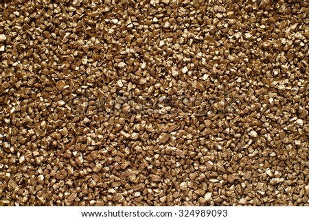 Small Gold Particles of Decoration Stones Background - stock photo