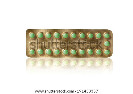 small green pills in a blister - stock photo