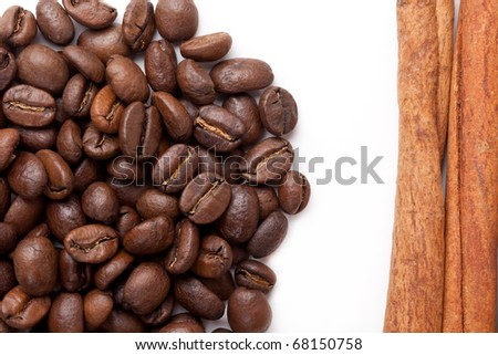 Small group of Coffee beans roasted and cinnamon sticks on a white background - stock photo
