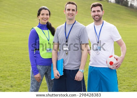 Small group of PE teachers smiling for a portrait - stock photo
