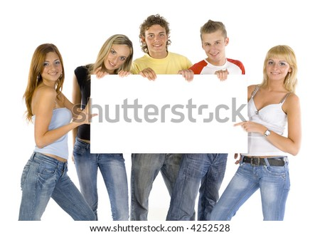 Small group of teenagers holding white blank board. Looking at camera. White background, front view - stock photo