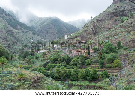 Small hamlets and villages in the canyon Barranco de la Laja on La Gomera. The Barranco is a well watered ravine with barrages to irrigation the terraced fields. The gulch is situated on the west side - stock photo