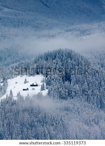 Small house in winter mountains - stock photo
