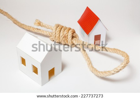 Small house with hangman's noose on white background - stock photo