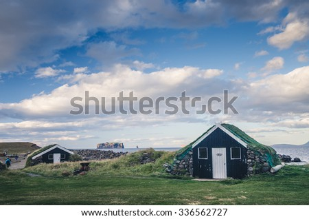 small houses in Iceland, grass on the roofs - stock photo