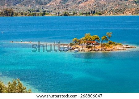 Small island in Aegean sea, Greece - stock photo