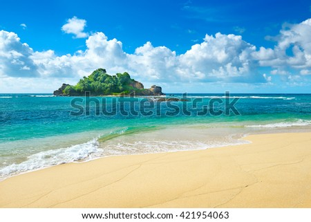 Small island in the ocean - stock photo