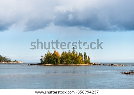 Small Island with Rain Clouds - stock photo