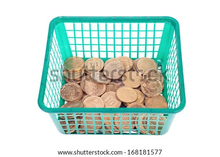 Small israeli coins in basket isolated on white background - stock photo