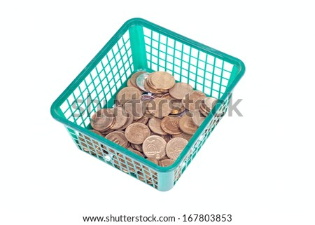 Small israeli coins in green basket isolated on white background - stock photo