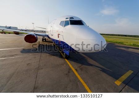 Small jetplane is on runway - stock photo