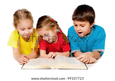 small kids lie on the floor with a book against white - stock photo