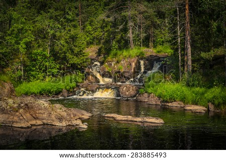 small lake before the forest waterfall - stock photo