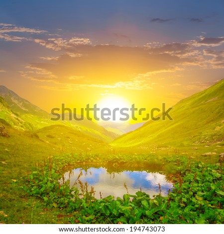 small lake in a mountain valley - stock photo