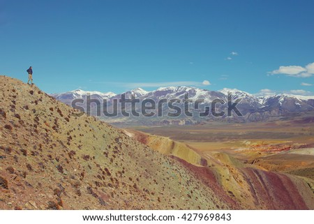 Small male person in huge mountains beautiful landscape. Outdoor adventure, freedom, enjoy nature - stock photo