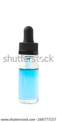 Small medical bottle with a pipette, filled with transparent blue liquid isolated over the white background - stock photo