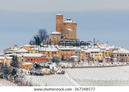 Small medieval town on snowy hill in Piedmont, Northern Italy. - stock photo
