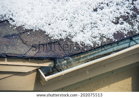 Small Melting Hail on the Roof. Severe Weather Concept. - stock photo