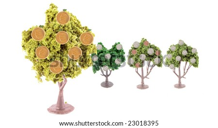 small miniature forest growing copper and silver dollars, yen, euros and British pound coins ... Euro tree is in front showing strength in currency exchange - stock photo