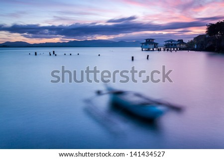 Small misty boats bobbing on the waves - stock photo