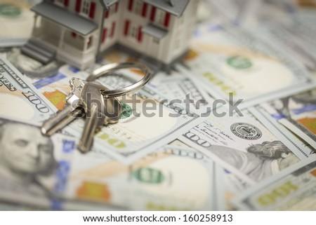 Small Model House and Keys on Newly Designed U.S. One Hundred Dollar Bills. - stock photo