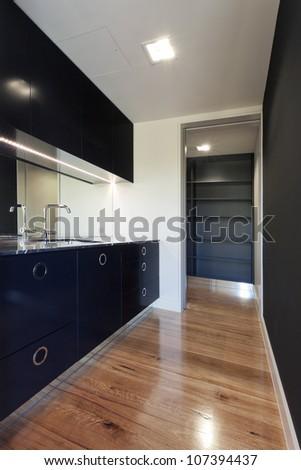 Small modern black kitchen - stock photo