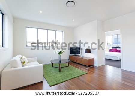 Small modern living room with TV and couch - stock photo