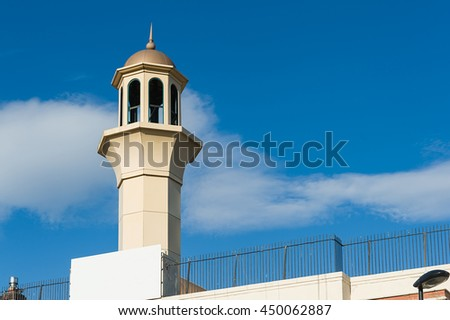 Small mosque tower against the blue sky. Birmingham, UK 2016. - stock photo