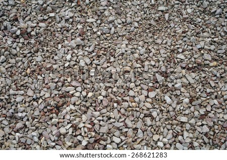 Small multi-colored rocks on the track - stock photo