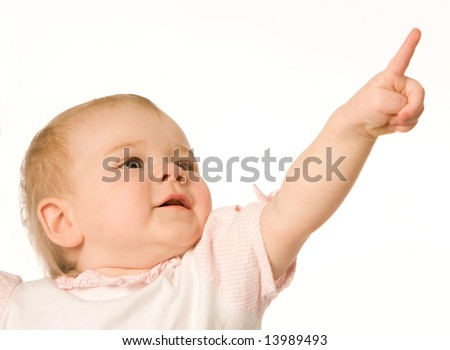 Small nice girl shows a finger upwards on a white background - stock photo