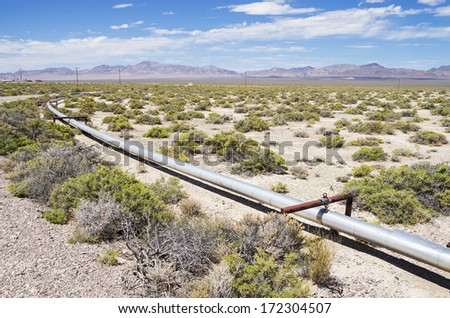 small oil pipeline in the desert in New Mexico - stock photo