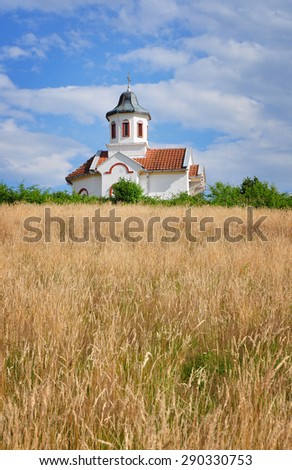 Small orthodox church in the countryside landscape - stock photo