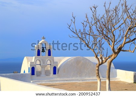 Small orthodox church painted blue and white on the island of Santorini, Greece - stock photo