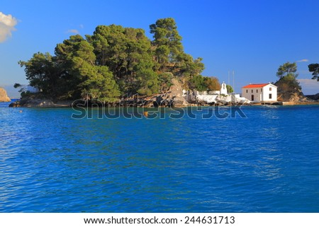 Small orthodox church painted white on a Greek island, Parga, Greece - stock photo