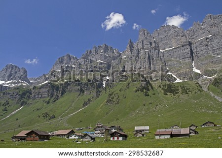 Small pasture settlement on the Urnerboden in Switzerland - stock photo