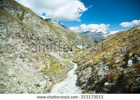 Small path between the mountens, Alps, Swiss - stock photo
