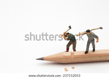Small people with Axe cutting the pencil - stock photo