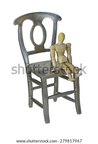Small person sitting on a large metal chair - path included - stock photo