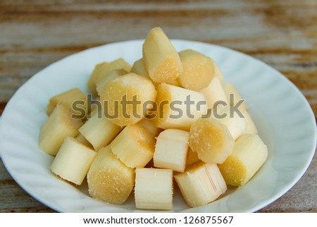 small pieces of sugarcane on white dish - stock photo