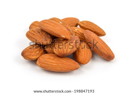 small pile of almonds on white background - stock photo