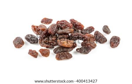 small pile of dark raisins over white - stock photo