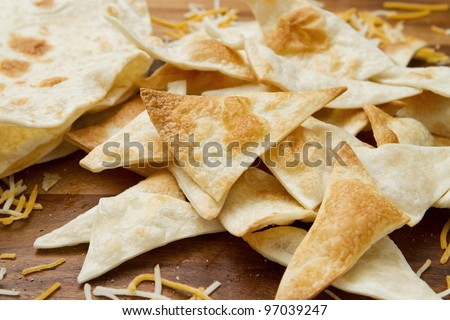 small pile of home made tortilla chips and cheese - stock photo