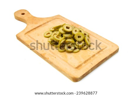 Small pile of sliced green olives isolated on chopping board on the white background  - stock photo