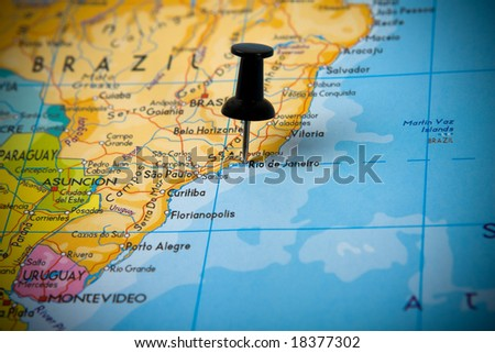 Small pin pointing on Rio de Janeiro (Brazil) in a map of South America - stock photo