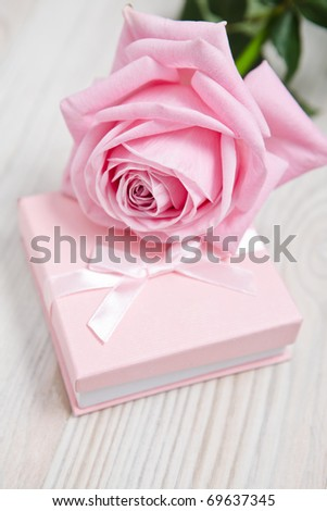 Small pink Valentine's day gift with tie. - stock photo