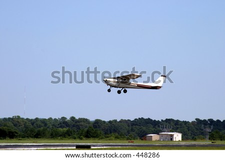 Small Plane Taking Off at a Local Airport - stock photo