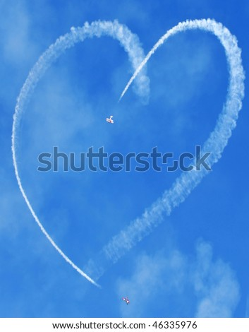 small planes making heart in sky - stock photo