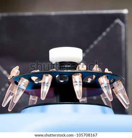 small plastic tube in centrifuge - stock photo